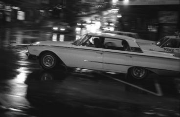 Murray Cammick - 1961 Ford Galaxie and police car at lights